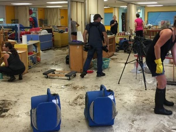 Volunteers restoring a flooded New Jersey preschool