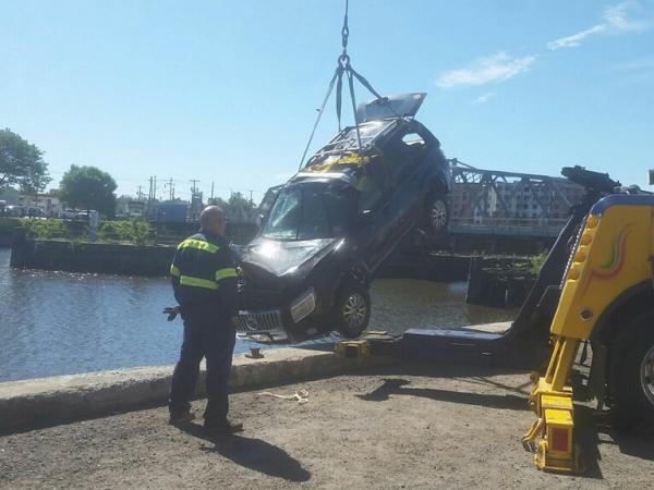 Man Jumps Into Passaic River To Save Woman From Sinking SUV