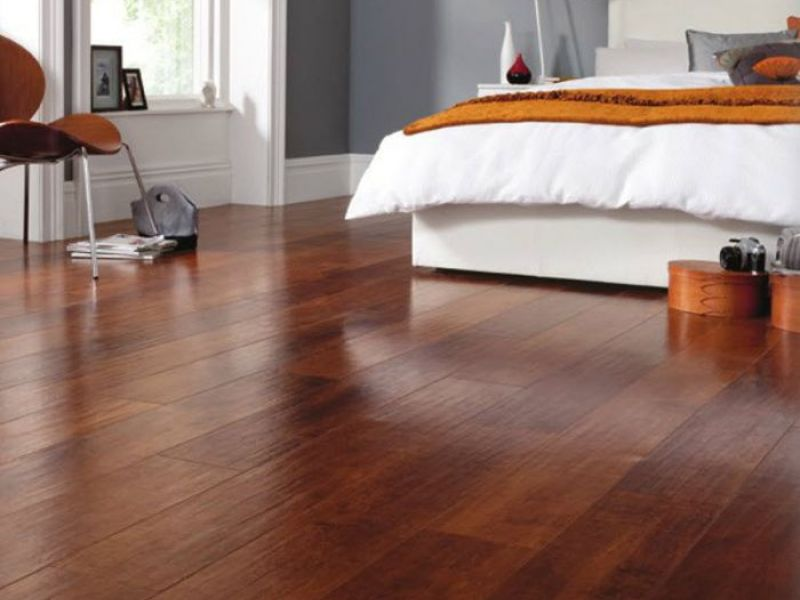 Pros and cons luxury vinyl tile vs hardwood flooring for Hardwood floors vs tile