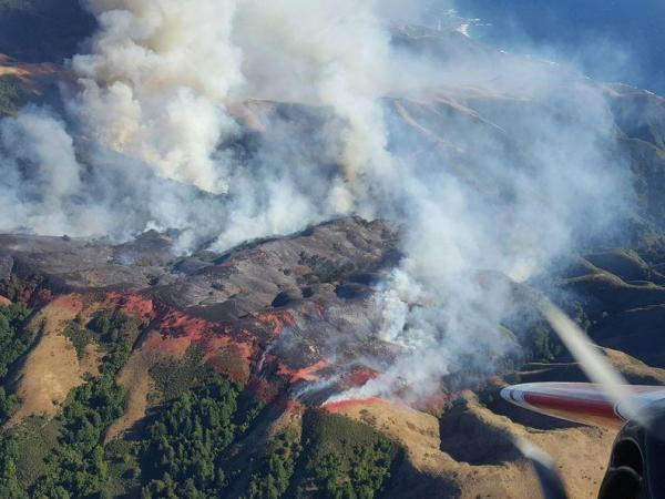 Hotter weather expected near blaze that killed 1