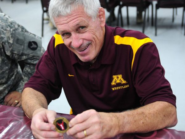 Minnesota fires wrestling coach after athletes drug scandal