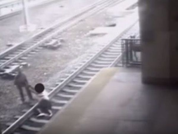 Transit cop saves man lying on train tracks as train approaches