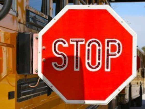 Calgary school bus driver ticketed for speeding through a playground zone