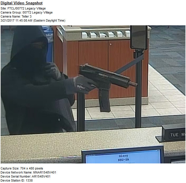 Man points gun at tellers, robs Fifth Third bank