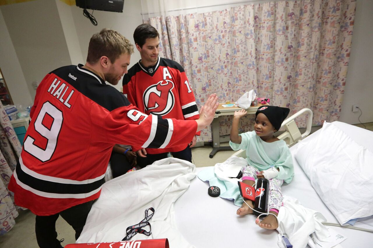 dbd679b31aa ... Hall and Adam Henrique high-five a young patient at the Childrens  Hospital of Bryce Salvador - Wikipedia Travis Zajac - Wikipedia New Jersey  Devils ...