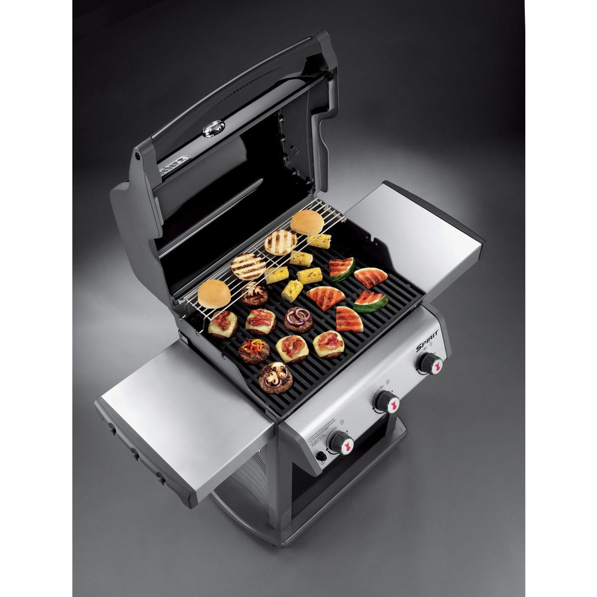 the spirit e310 lp gas grill has two fulluse stainless steel tables and a durable shroud that wonu0027t ever fade peel or rust