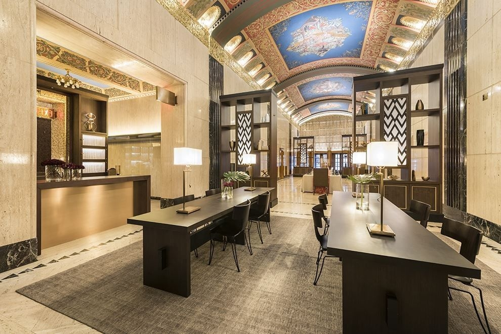 the building is famous for its lobby which is a new york city landmark and includes handpainted murals and chandeliers according to curbed new york