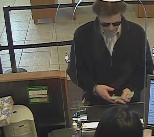 surveillance photos released in buffalo grove bank robbery