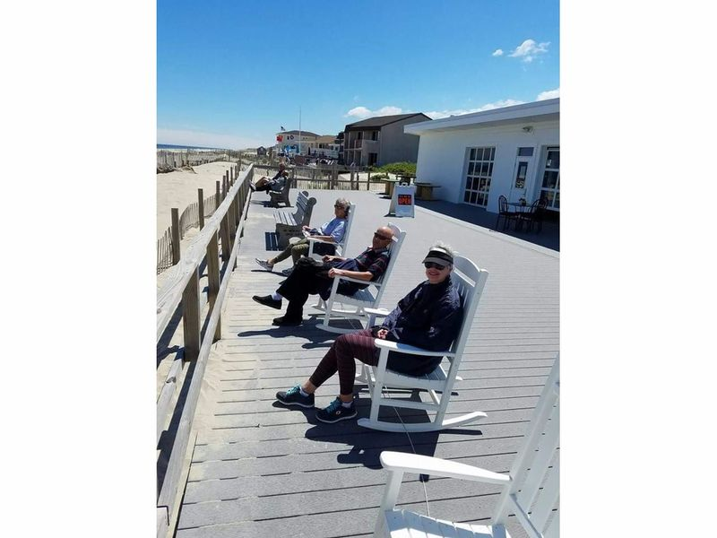 Rocking Chairs On Point Beach Boardwalk Are